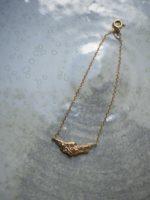 Rock on gold bracelet