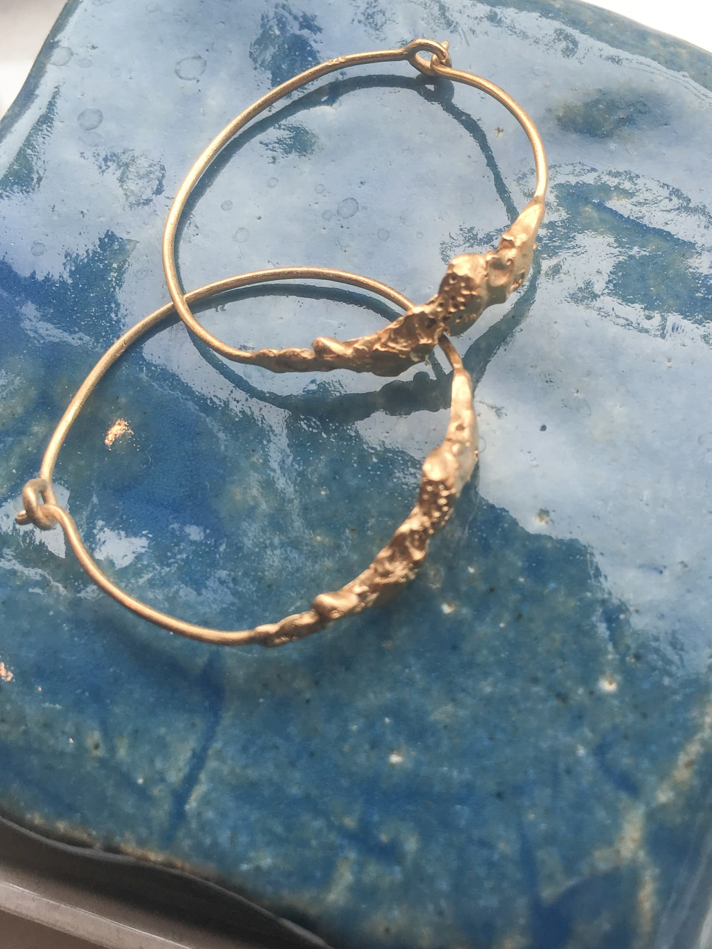 Rock on gold hoops